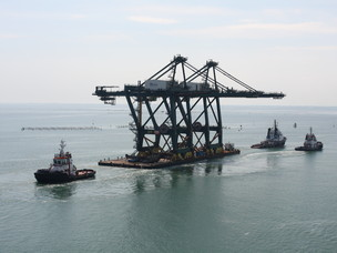 The cranes are towed by 3 tugs