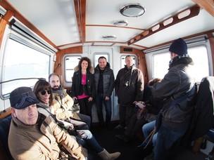 I partecipanti all'interno della pilotina che li ha portati al Lido