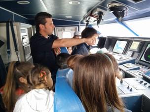 A bordo della motovedetta della Guardia Costiera